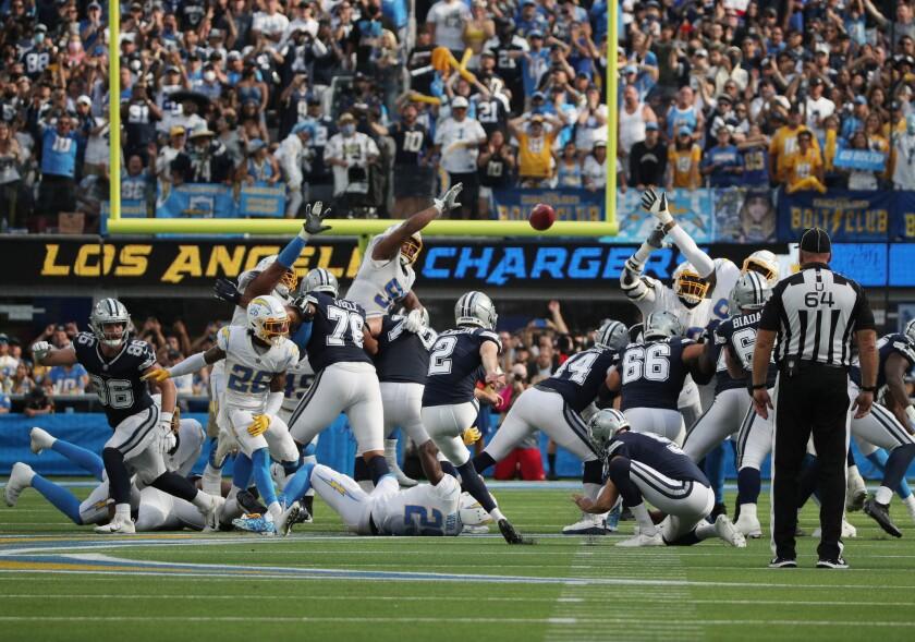 Dallas Cowboys kicker Greg Zuerlein (2) kicks a 56-yard field goal.