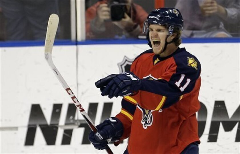 Florida Panthers' Jonathan Huberdeau celebrates the Panthers first goal of the game against the New Jersey Devils during the first period of a NHL hockey game in Sunrise, Fla., Saturday, March 30, 2013. (AP Photo/J Pat Carter)