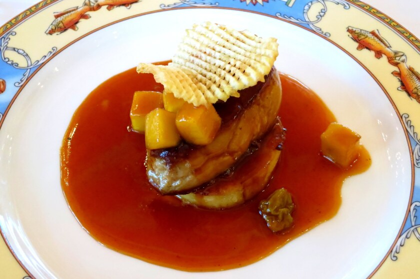 Duck foie gras with passion fruit sauce at Paul Bocuse in Lyon, France.