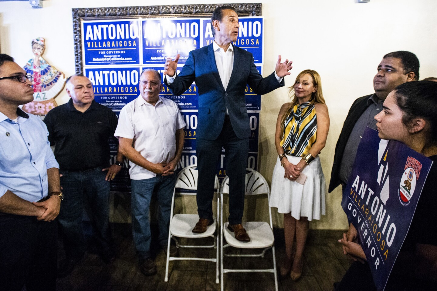 Gubernatorial candidate Antonio Villaraigosa, center, speaks at a campaign event with a carpenters union at a Riverside restaurant on Sunday.