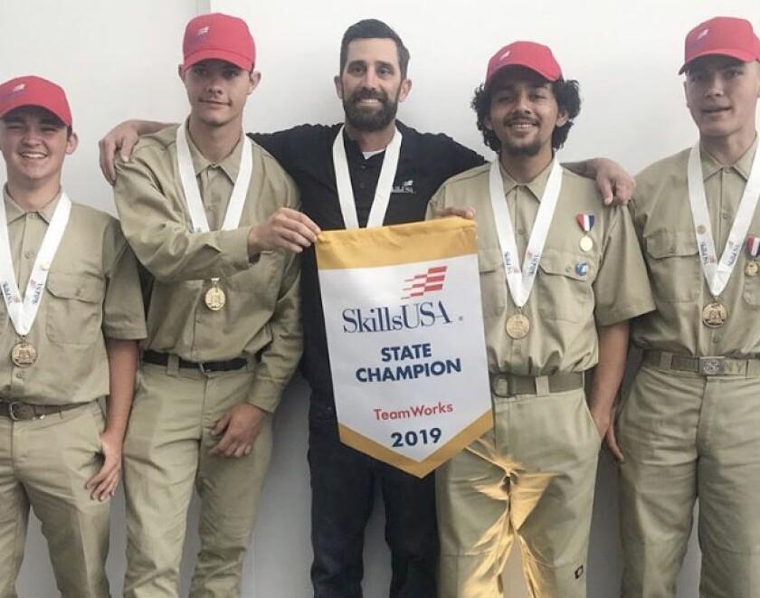 Teacher Nicholas Jordan joins his SkillsUSA 2019 state winners, Chris Coleman, Dale Tash, Manuel Marino and Michael Caparas.