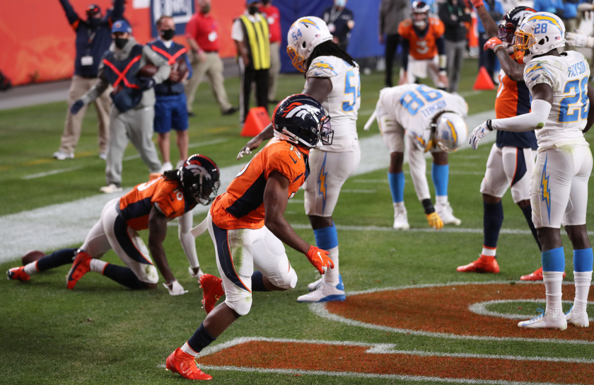 Denver Broncos wide receiver KJ Hamler runs as he celebrates his last-second touchdown.