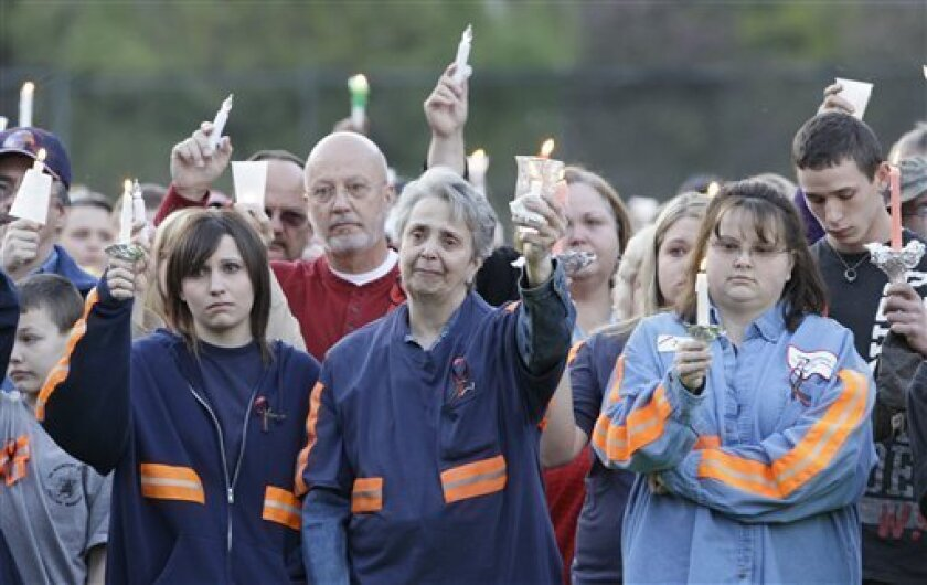 """File- In this file April 10, 2010 file photo, people from the coal mining towns along the Coal River participate in a memorial vigil in Naoma, W.Va., for 29 miners who died in the explosion at Massey Energy Co.'s Upper Big Branch mine in Montcoal, W.Va. A year since the disaster, Massey Energy company and their CEO Don Blankenship, """" King of Coal"""" , are no longer around.(AP Photo/Amy Sancetta, File)"""