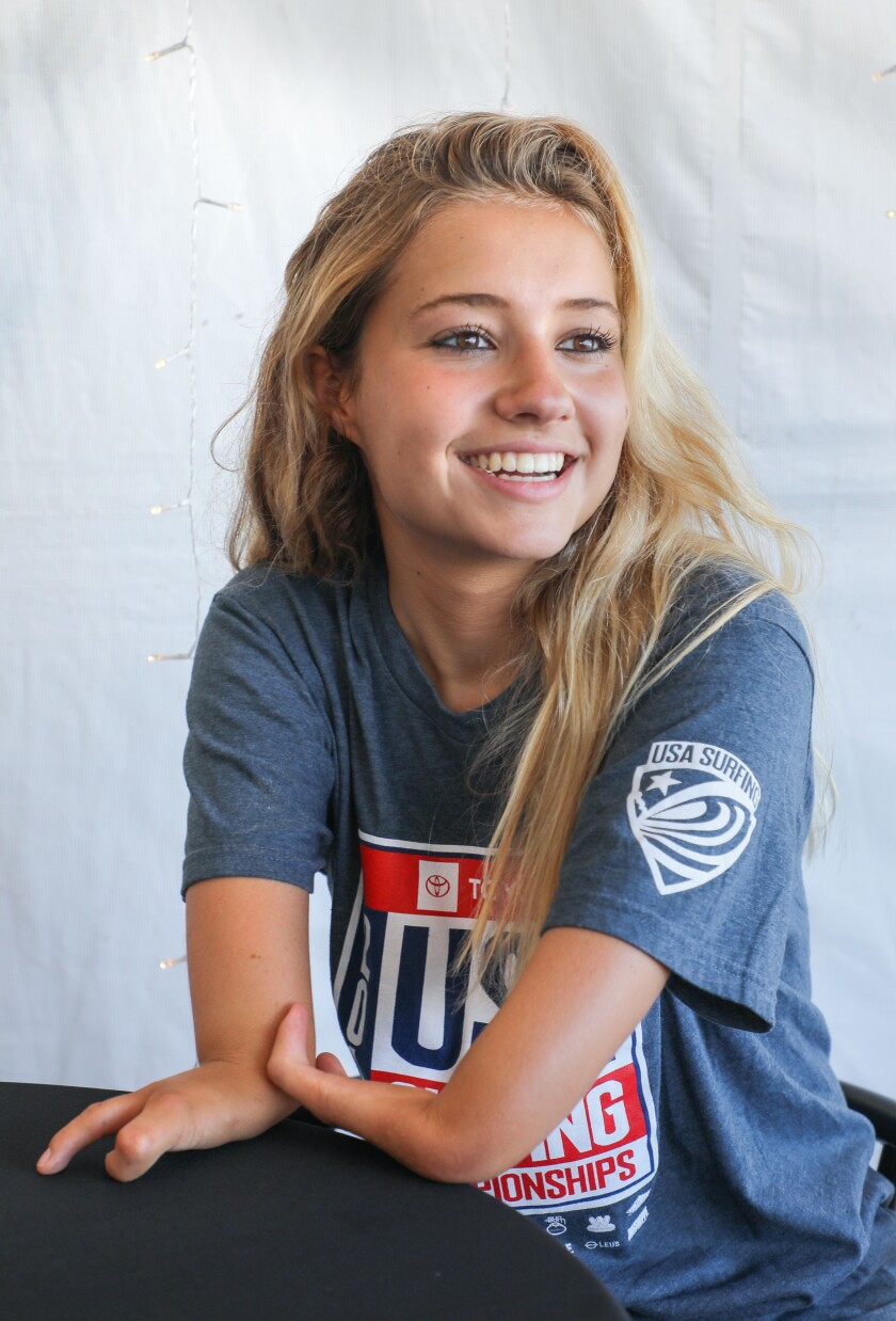Adaptive surfer Liv Stone, 16, of Carlsbad, who was born with a congenital deformity of her arms, talks Friday about competing for the first time Sunday in the Super Girl Surf Pro competition at Oceanside Pier this weekend.