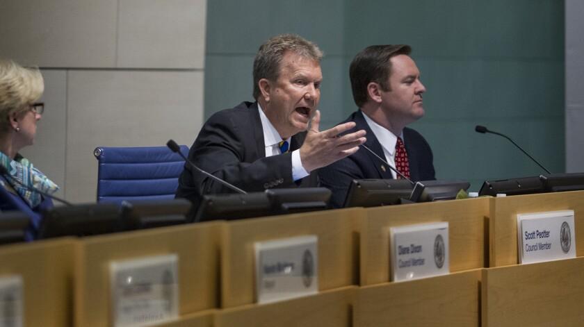 Newport Beach Councilman Scott Peotter responds after being served an intent to recall notice during