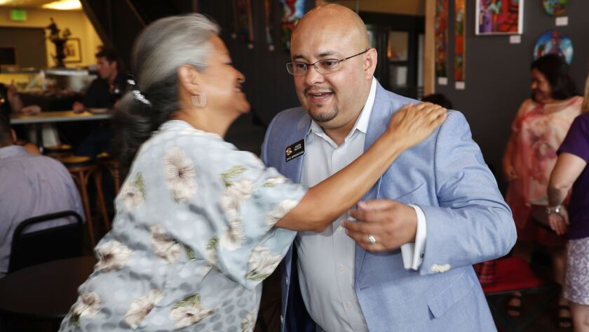 Joe Salazar, one of two Democrats seeking the party's nomination to run for attorney general in Colorado, greets a supporter during a fundraising event in Denver on May 24, 2018.