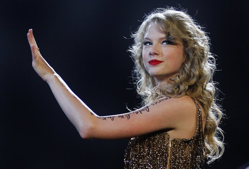 Taylor Swift, shown at her most recent San Diego concert last year, tops the list of Forbes magazine's top money-earners under the age of 30.