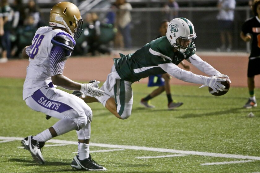 St. Augustine's Tariq Thompson can only watch as Oceanside's Johnny Arzola dives into the end zone for a touchdown.