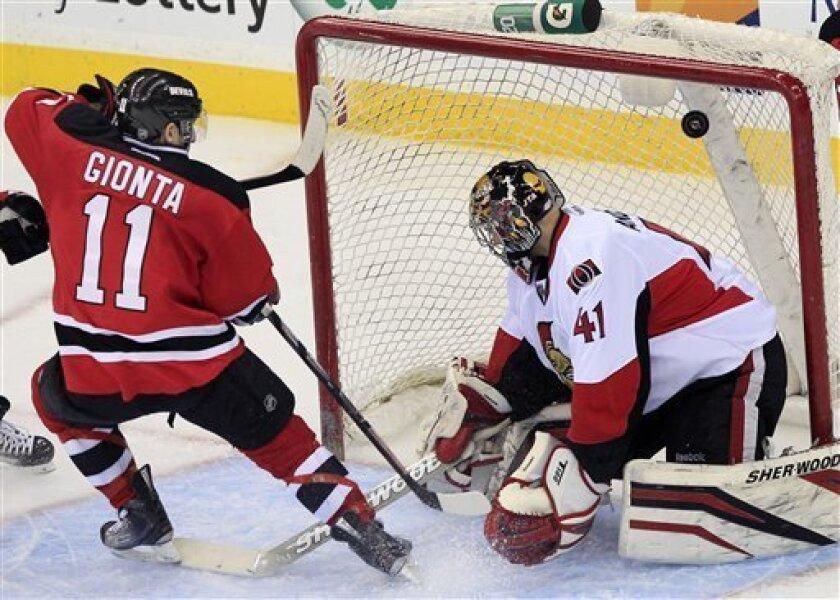 New Jersey Devils' Stephen Gionta (11) scores his first goal with the Devils past Ottawa Senators goalie Craig Anderson (41) during the third period of an NHL hockey game in Newark, N.J., Saturday, April 7, 2012. The Devils won 4-2. (AP Photo/Mel Evans)