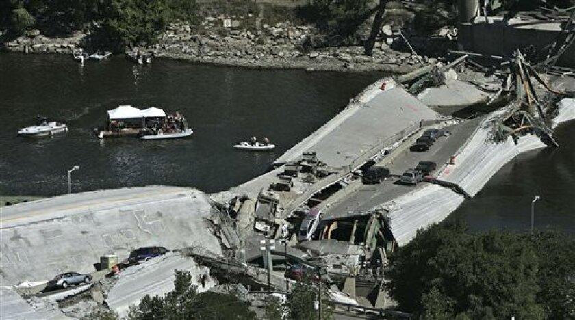 FILE - This Aug. 3, 2007, file photo shows divers during recovery efforts following the 35W bridge collapsed in Minneapolis. Historians, safety officials, educators and victims of the collapse would have six months to claim remnant steel from it under a bill the Minnesota House is set to vote on Monday, May 6, 2013. Their parts would come free, but the rest of the 3,000-plus tons of rusting steel would be sold for scrap and net the state as much as $650,000. (AP Photo/Minneapolis Star Tribune,
