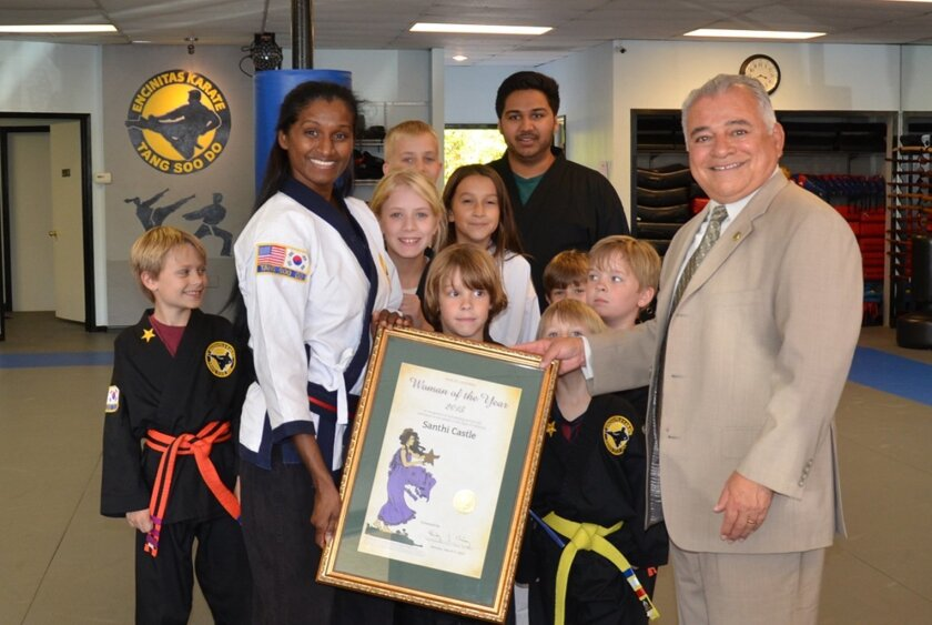 State Rep. Rocky Chavez visited Castle's studio to present the award again with her students present. Courtesy photos