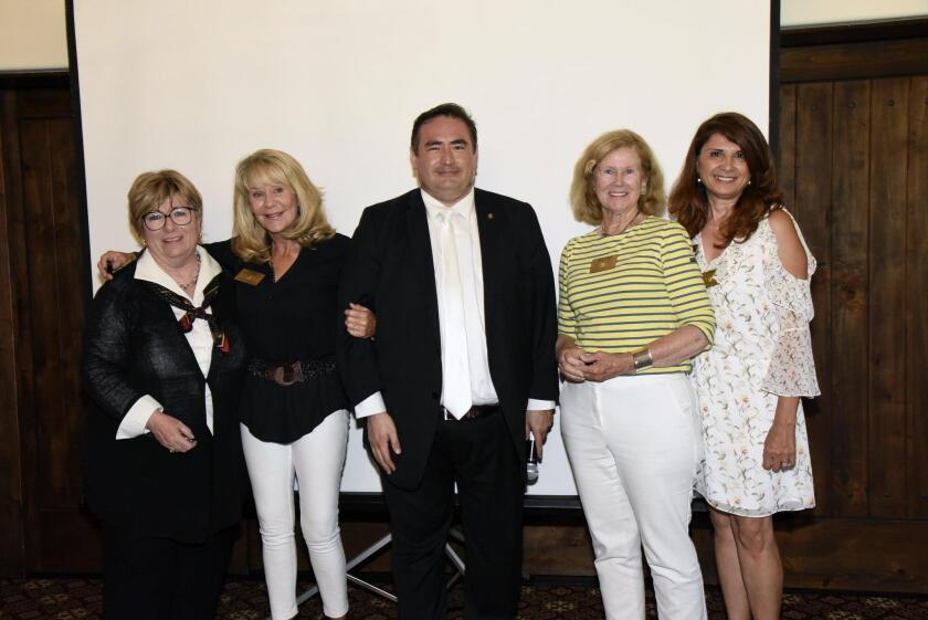 President Luis Carranza (center) recognized Norma Wiberg, Robin Chappelow, Heather Manion, and Jamie Palizban for their dedicated Rotary service