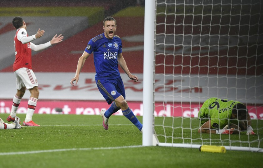 Leicester's Jamie Vardy celebrates after scoring his team's first goal during the English Premier League soccer match between Southampton and Manchester City at St. Mary's Stadium in Southampton, England, Sunday, July 5, 2020. (AP Photo/Will Oliver,Pool)
