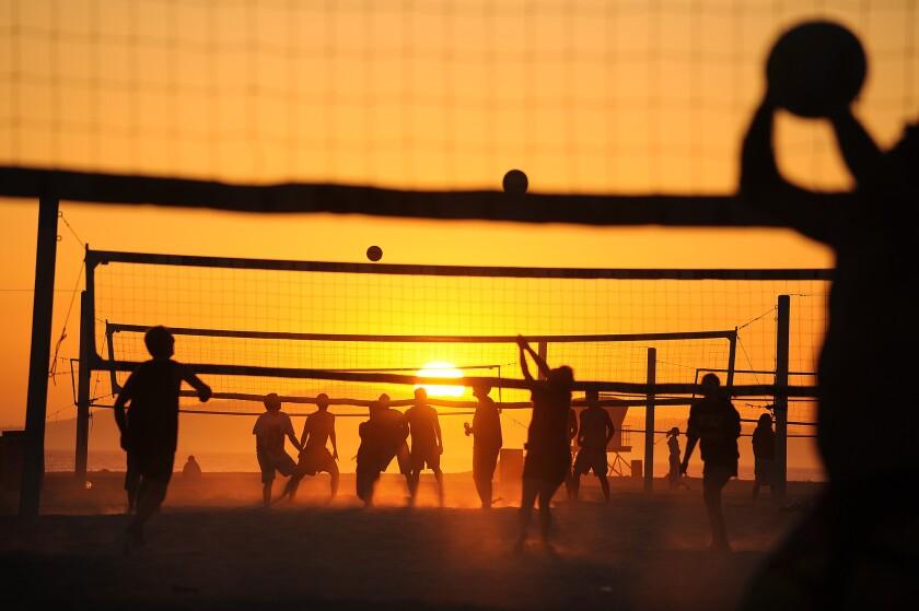 Beachgoers at Huntington Beach Pier
