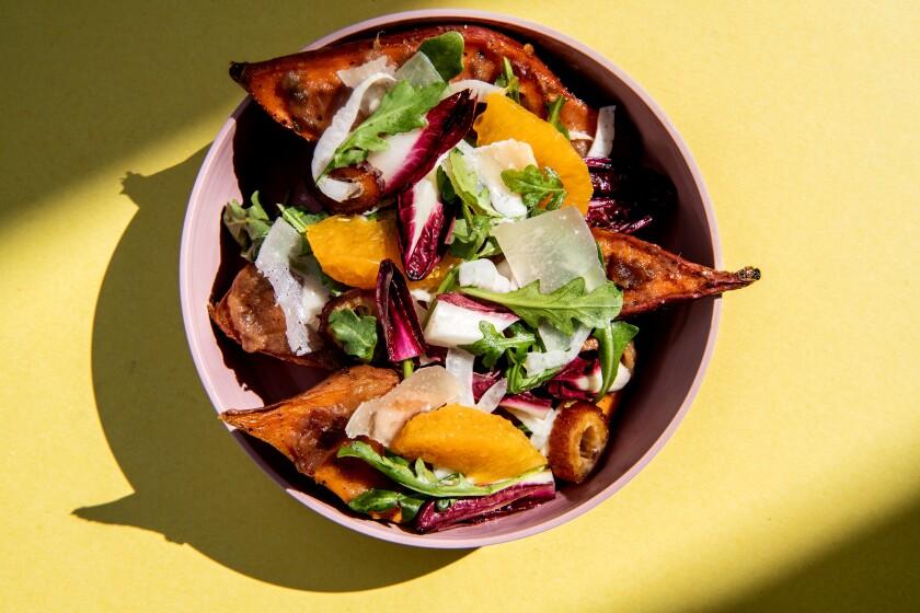 Cold crisp salad tops hot sweet potatoes.