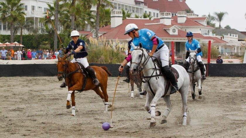 At the Polo America Beach Polo Cup in Coronado, Aspen Valley Polo Club controls the ball with U.S. Polo Association in pursuit during Sunday match up.
