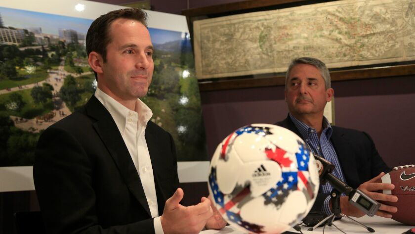 Nick Stone, left, partner with FS Investors, and Steve Altman, former Qualcomm president, detail their proposal to redevelop the Qualcomm Stadium site.