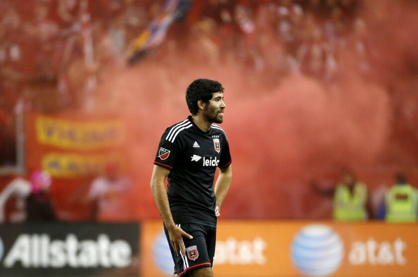 D.C. United midfielder Miguel Aguilar walks off the field after his team lost 1-0 to the New York Red Bulls during an MLS playoff soccer match, Sunday, Nov. 8, 2015, in Harrison, N.J. (AP Photo/Julio Cortez)