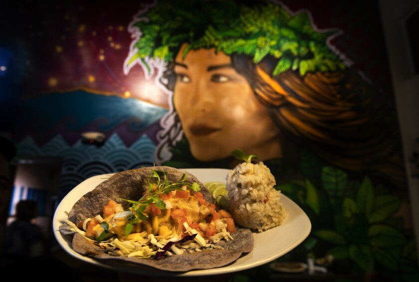 Grilled local fish tacos with a side of coconut rice, are on the menu at Hula Hula's restaurant at the Grand Naniloa Resort in Hilo, Hawaii.