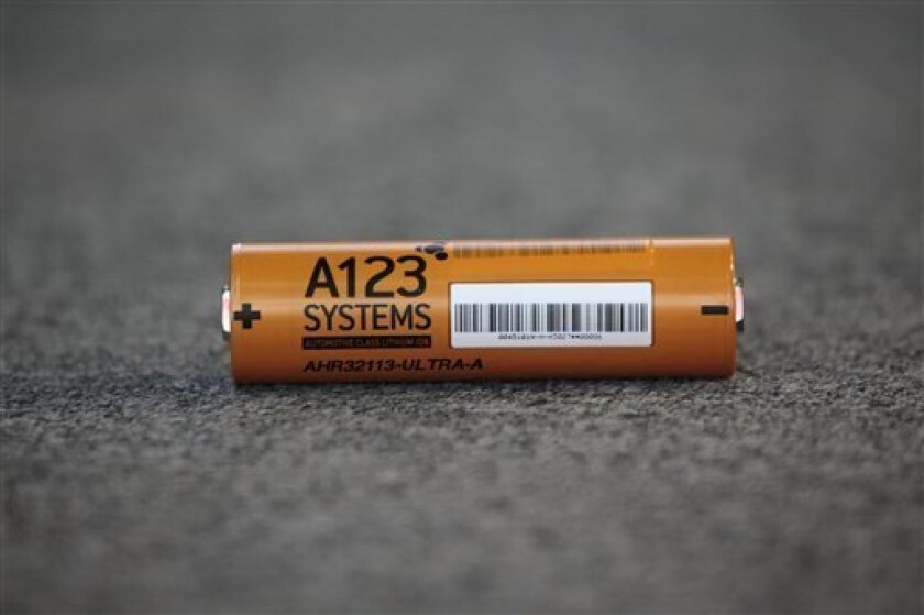 FILE - In this Thursday, Aug. 6, 2009, file photo, an A123 Systems Inc. high power Nanophospate Lithium Ion Cell for Hybrid Electric Vehicles battery is displayed in Livonia, Mich. Bankrupt battery maker A123 Systems Inc. on Sunday, Dec. 9, 2012, said it will sell most of its assets to the U.S. arm of Chinese auto parts conglomerate Wanxiang Group Corp. for $256.6 million. Wanxiang America Corp. won an auction conducted under the supervision of the U.S. Bankruptcy Court for the District of Delaware. (AP Photo/Paul Sancya, File)