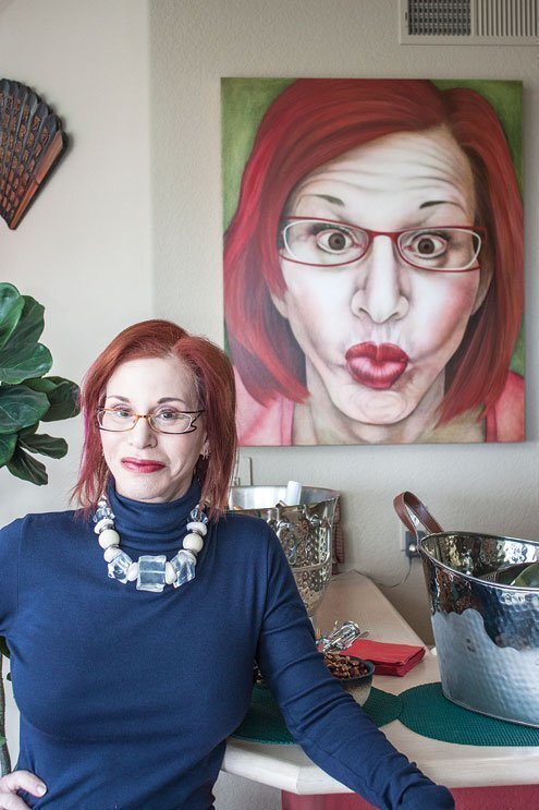 The real Robin Lipman poses with Vicki Walsh's painting of her.