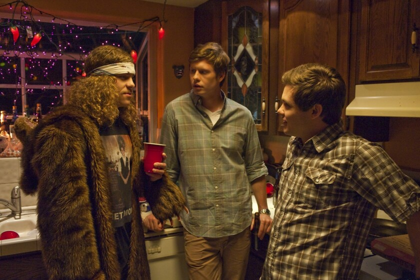 "Actor Anders Holm, middle, in a scene from ""Workaholics."""
