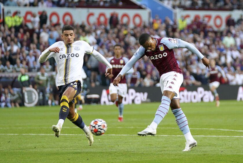 Aston Villa's Leon Bailey, right, scores during the English Premier League soccer match between Aston Villa and Everton at Villa Park, Birmingham, England, Saturday Sept. 18, 2021. (Tim Goode/PA via AP)