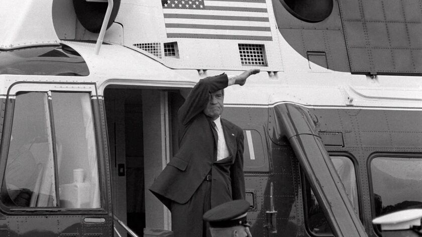 Richard M. Nixon waves goodbye from the steps of his helicopter as he leaves the White House after resigning as president.