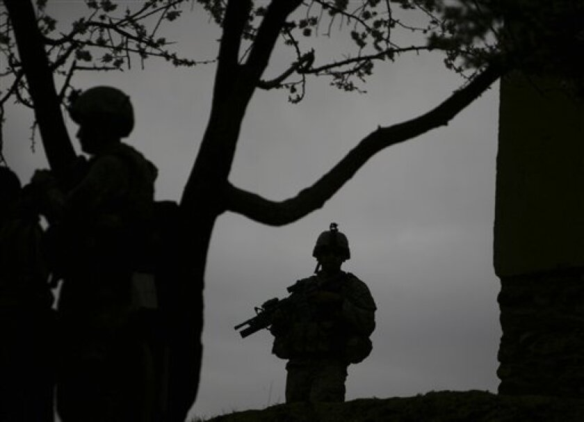 In this Friday, May 1, 2009 photo, U.S. soldiers of 3rd Brigade, 10th Mountain Division, patrol during a search operation to hunt members of the Taliban in Nerkh district of Wardak province in west of Kabul, Afghanistan. The fight in Wardak province now involves more roadside bombs and less direct