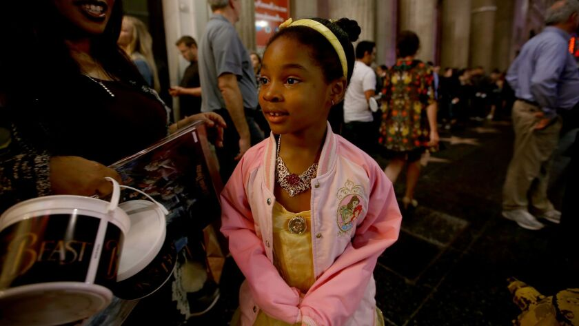 """Skylar Gordon, 7, of Los Angeles is all smiles as she exits """"Beauty and the Beast"""" at Hollywood's El Capitan Theatre."""