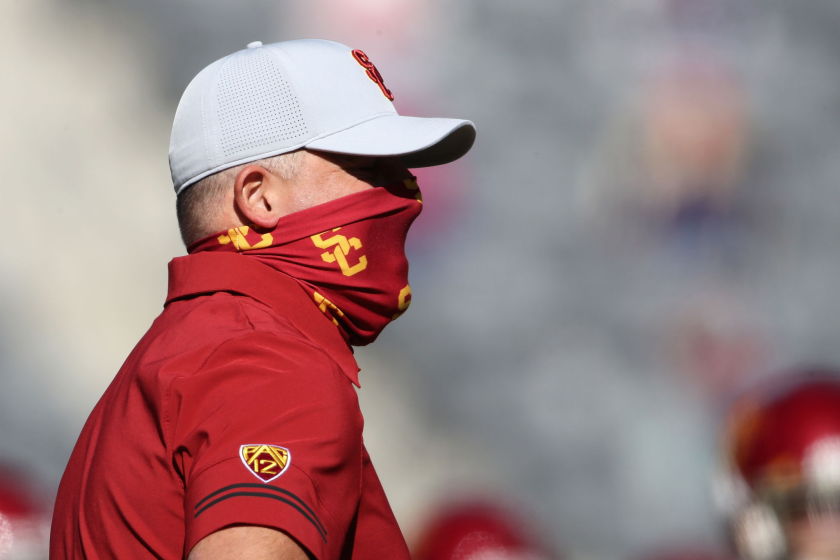 USC coach Clay Helton looks on during warmups before the Trojans faced Arizona on Nov. 14, 2020.