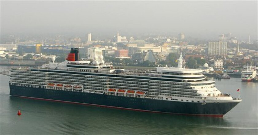 Cunard's newest cruise liner the Queen Elizabeth arrives in Southampton, southern England for the first time Friday Oct. 8, 2010. She will be officially named by Queen Elizabeth II in the city on Monday. (AP Photo/Chris Ison/PA Wire)