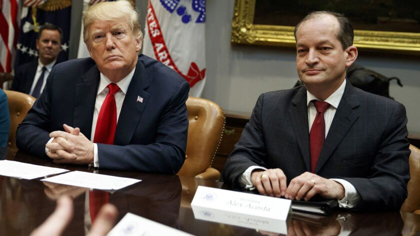 President Trump, left, and Labor Secretary R. Alexander Acosta listen during a White House meeting Sept. 17, 2018.