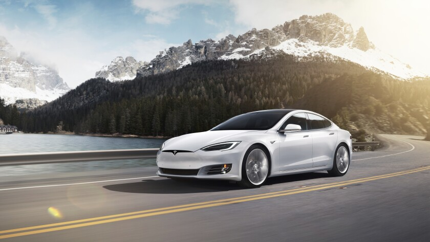 This photo provided by Tesla shows the Tesla Model S, which offers the longest range of any EV on the market. With an EPA-estimated range of 402 miles in its Long Range Plus trim level, the Model S should be able to take you far from home without any range anxiety. (Courtesy of Tesla via AP)