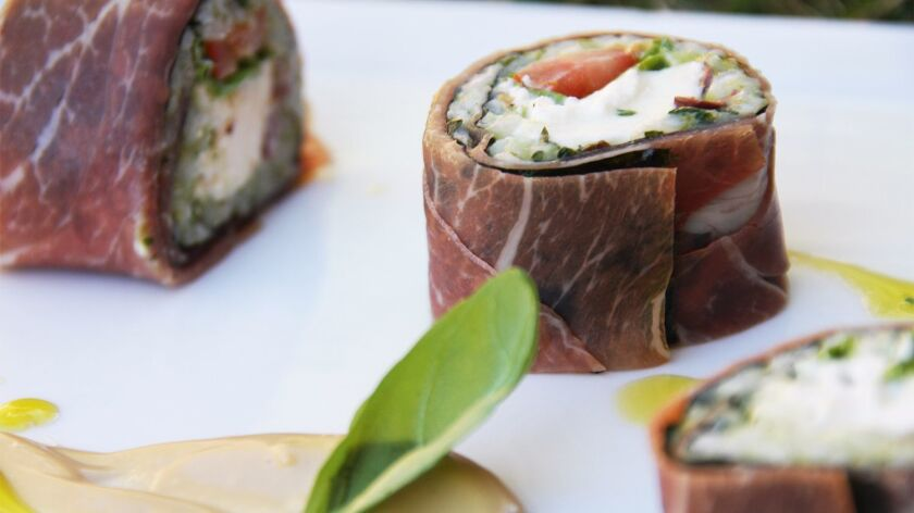 Mediterranean-style rolls, this one made with prosciutto, burrata cheese and pesto rice, are among the featured items at Crudo by Pascal Lorange in Carmel Valley.