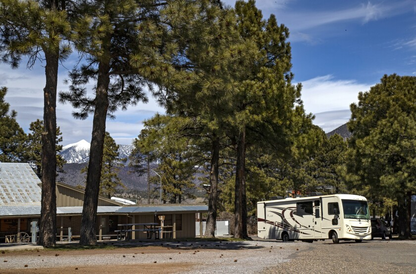 An RV pulls into Black Bart's RV Park in Flagstaff, Ariz., during the pandemic.