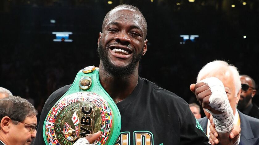 Deontay Wilder celebrates after knocking out Dominic Breazeale in the first round of their WBC title fight on May 18.