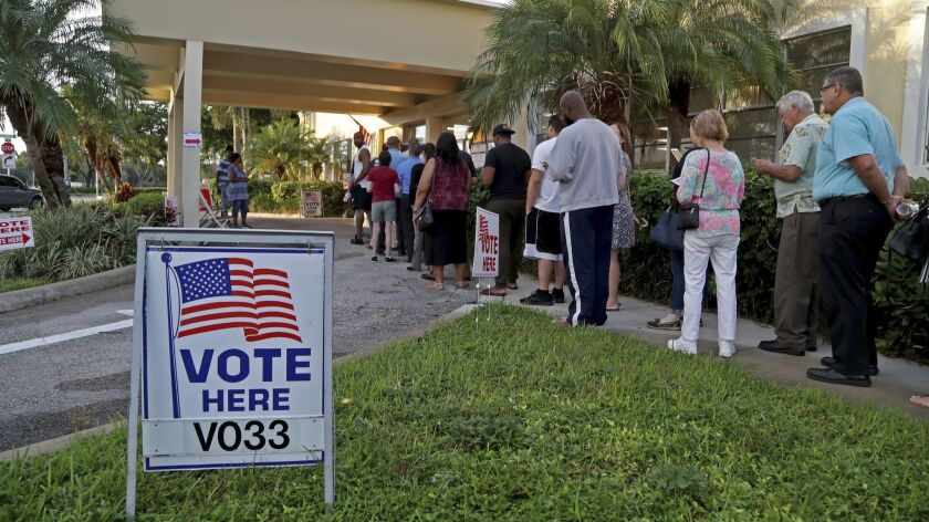 Voters line up as the polls open at David Park Community Center in Hollywood, Fla., on Nov. 6.