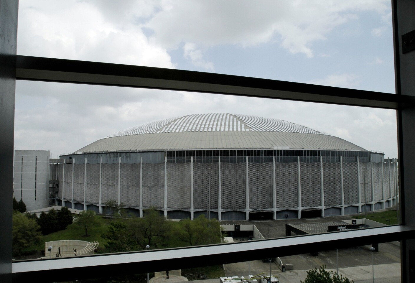 """Houston's Astrodome, once called """"The Eighth Wonder of the World,"""" is seen through the windows of the Club Level of Reliant Stadium."""