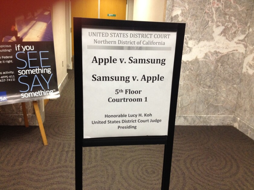 A sign for the Apple vs. Samsung patent infringement trial in federal court in San Jose.