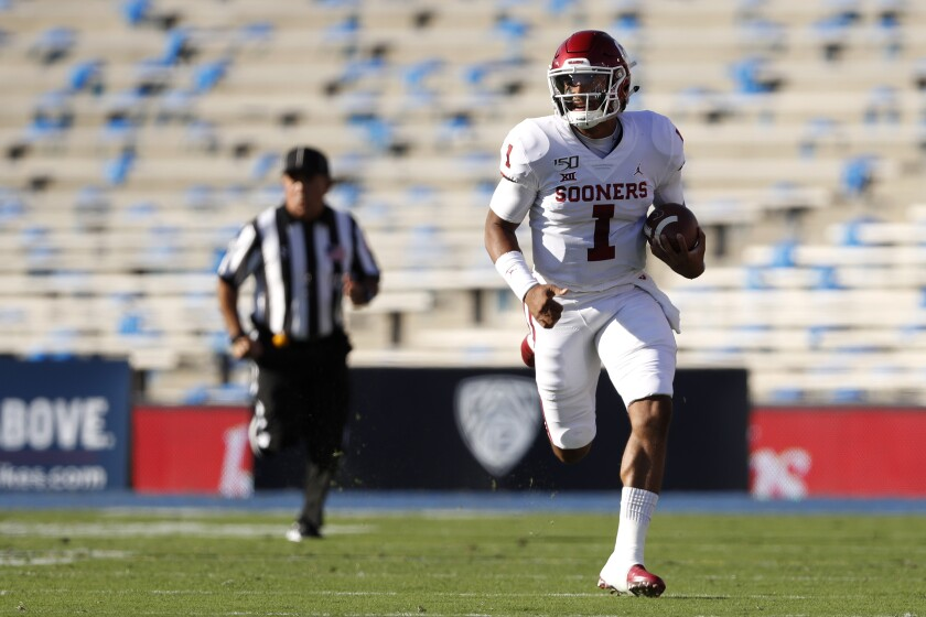 Oklahoma quarterback Jalen Hurts sprints with the ball in front of a plethora of open seats at the Rose Bowl on Saturday.