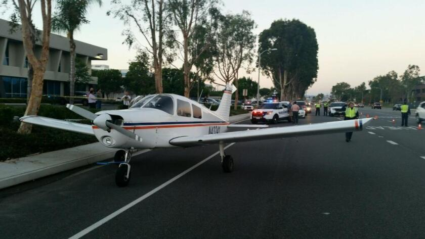 A small plane made an emergency landing on Red Hill Avenue in Irvine, near John Wayne Airport. No one was hurt, authorities said.