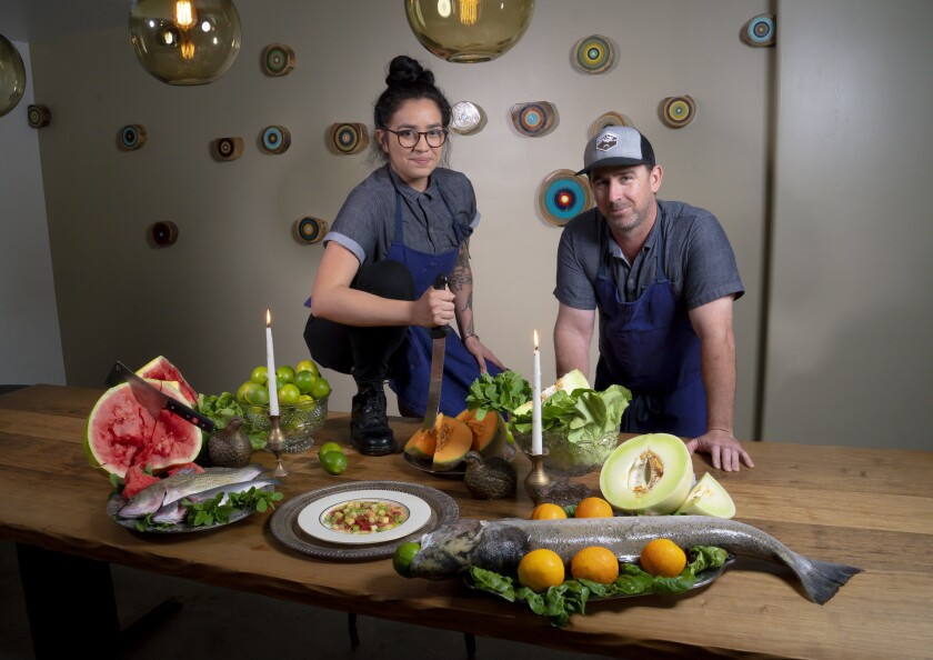 Chef Ryan Johnston (right), culinary director of Whisknladle and chef de cuisine Natallie Avitia.