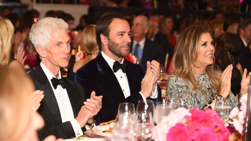 Richard Buckley, left, honoree Tom Ford and honorary co-chair Rita Wilson sit together at An Unforgettable Evening on Feb. 16 in Beverly Hills.