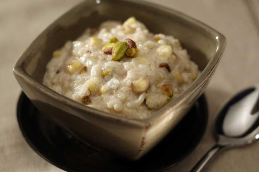 """<a href=""""http://www.latimes.com/features/food/la-fo-sos7-2009oct07,0,6207472.story"""" target=""""_blank""""><span style=""""color:#2262CC"""">Chilled banana and pistachio rice pudding</span></a."""
