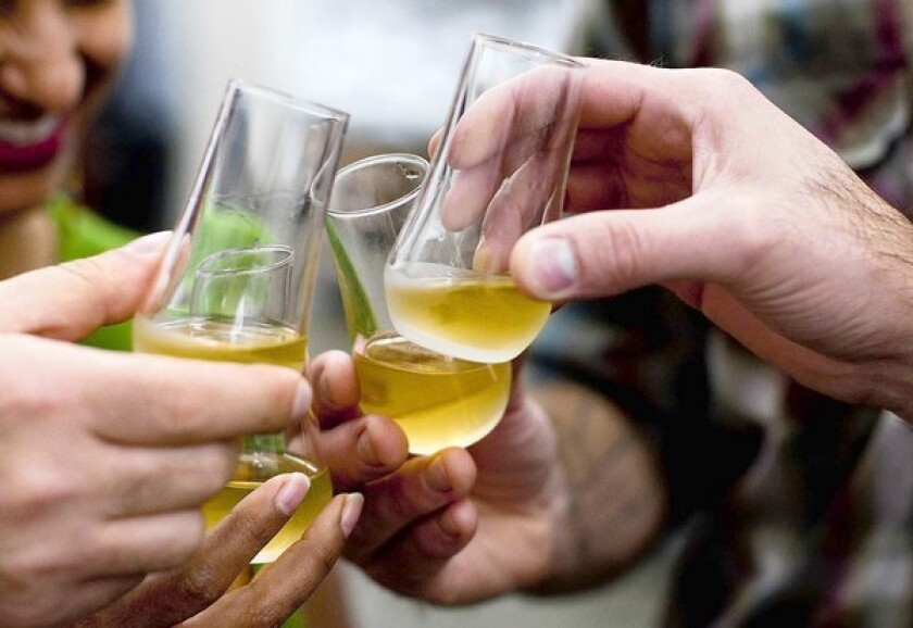 Taste testers try TRU Organic gin, which has been distilled for two months, at Modern Spirits distillery in Monrovia.