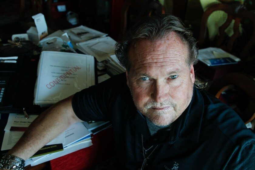 Private investigator Joseph Travers in a file photo taken at his Oceanside home, where he runs nonprofit Saved in America, works to recover runaways at risk for being forced into sex trafficking. Travers and his charity are now being sued for fraud.