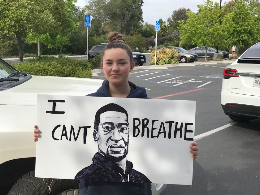 R. Roger Rowe student Fabiola Theberge at the peaceful protest on June 2.