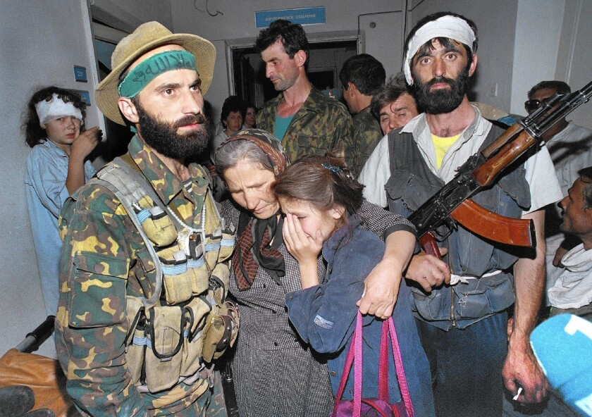 Chechen rebel leader Shamil Basayev, left, took hundreds of hostages at a hospital in Budennovsk, Russia, in 1995.