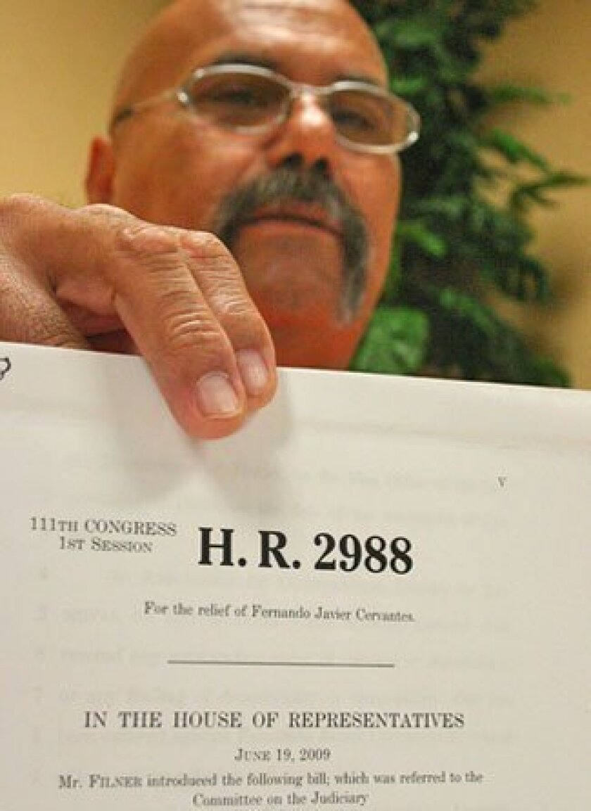 Fernando Cervantes held a bill that would spare the Army veteran from being deported. (Hiram Soto / U-T)